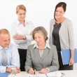 Business team pretty businesswomen with colleagues — Stock Photo