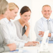 Business team pretty businesswomen with colleagues — Stock Photo #7735902