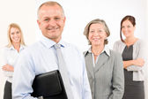 Business team happy mature man with colleagues — Stock Photo