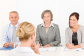 Job interview young woman with business team — Stock Photo