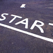 Stock Photo: Runners track beginning marked by word start