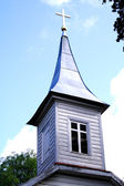 Church tower with lighted cross on roof — Stock Photo