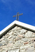 Cross from metal at old church roof — Stock Photo
