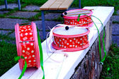Pink decorated drums laying on white bench — ストック写真