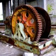 Rusty mine shaft mechanism on dusty ground — Stock Photo