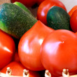 Stock Photo: Foto of cucumber and tomatoes laying nearby