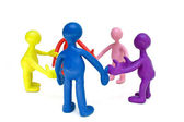 Look on group of plasticine colored puppets — Stock Photo