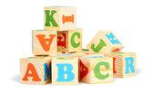 Alphabet wood blocks forming — Stock Photo