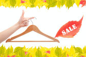Hanger and hand,autumn sale — Stock Photo