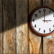 Clock on background the old wall wooden. — Stock Photo