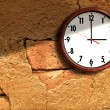 Clock on the old wall cement. — Stock Photo