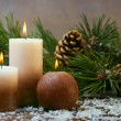 Candles and pine branches - Stock Photo