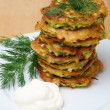Zucchini fritters  with sour cream - Stock Photo