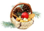 Christmas basket with candies, cookies and spruce branches. — Stock Photo