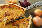Alsatian onion pie with ham. — Stock Photo