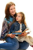 Merry mother and the little girl reading a book. — Stock Photo