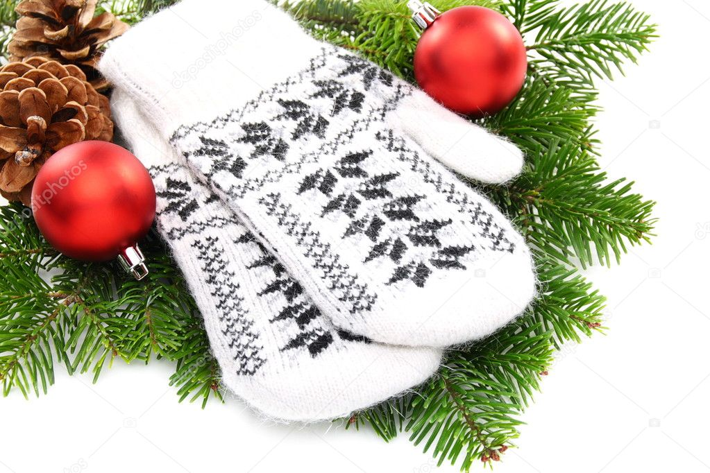 Christmas still life with mittens and balls on a white background. — Stock Photo #7411673