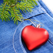 Christmas tree and toy on denim background. — Stock Photo