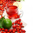 Vitamin tewith rose hips and lemon. — Stockfoto #7518409