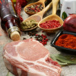 Fresh raw pork meat and spices. — Foto de Stock