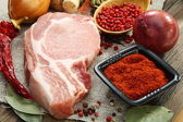 Fresh raw pork meat and spices. — Stock Photo