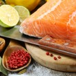 Fresh salmon fillet with herbs and spices. - Stock Photo