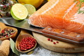 Fresh salmon fillet with herbs and spices. — Stock Photo