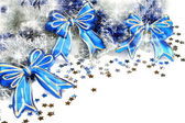 Christmas garland with blue ribbons. — Stock Photo