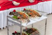 Celebratory food: stuffed fish on served table — Stock Photo