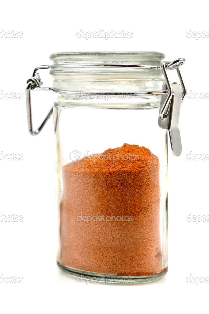 Red pepper powder in jar isolated on white — Stock Photo #7287142