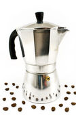 Aluminum espresso coffee maker with coffee beans — Stock Photo
