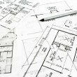 Stock Photo: House plan blueprints with pencil