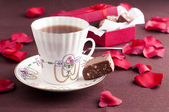 Tea and chocolate — Stock Photo