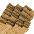 Stack of pine boards on white background — Zdjęcie stockowe #7493368