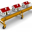 Three houses are moving on conveyor belt — Stock Photo