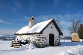 Cottage in winter landscape — Stock Photo