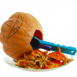 Halloween jack o lantern hollowing out the gourd with spoon — Stock Photo
