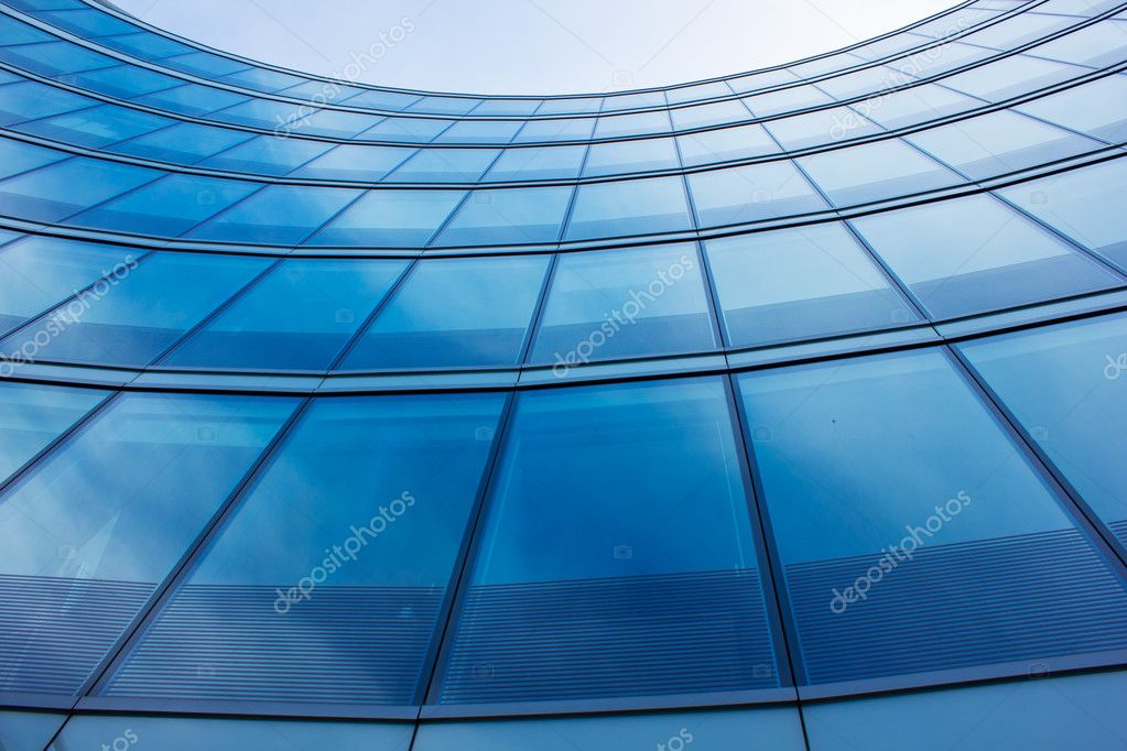 Wall of modern building with reflection of sky and clouds — Stock Photo #6948909