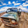 Dirty jeep in desert — Stock Photo