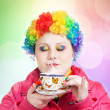 Rainbow Clown with cup of tea — Stock Photo