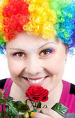 Clown with rainbow make up with rose — Stock Photo