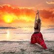 Yoga virabhadrasana warrior pose at sunset — Stock Photo