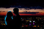 Couple silhouette at night city — Stock Photo