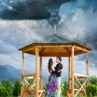 Hugging couple in tornado — Stock Photo
