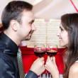 Couple with glasses of wine near piano — Stock Photo #6927843