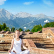 Urban Yoga meditation in ardha padmasana — Stock Photo