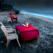 Romantic café on the beach at night - Stockfoto