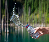 Bottle of water with splashes — Stock Photo