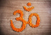 Om symbol from chopped carrot — Stock Photo
