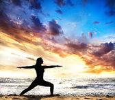 Yoga silhouette warrior II pose — Stock Photo
